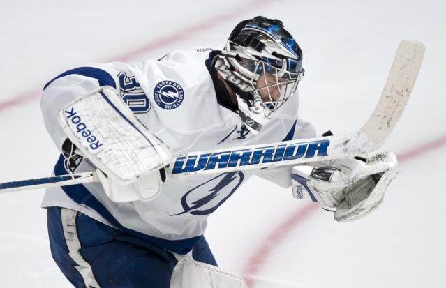Tampa Bay Lightning goalie Ben Bishop reacts after stopping Montreal Canadiens' Brendan Gallagher during the shootout of an NHL hockey game Tuesday, Nov. 12, 2013, in Montreal. The Lightning won 2-1. (AP Photo/The Canadian Press, Paul Chiasson)