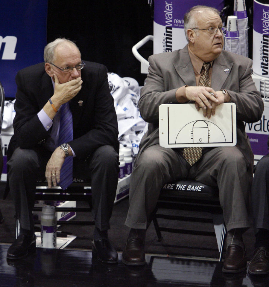 "FILE - In this March 25, 2010, file photo, Syracuse coach Jim Boeheim, left, and associate head basketball coach Bernie Fine sit on the bench at the end an NCAA West Regional semifinal college basketball game against Butler in Salt Lake City. Fine was fired Sunday, Nov. 27, 2011, in the wake of an investigation of child molestation allegations against him. In statement released Sunday night, Kevin Quinn, the school's senior vice president for public affairs, says Fine has been ""terminated, effective immediately."" (AP Photo/Steve C. Wilson, File)"