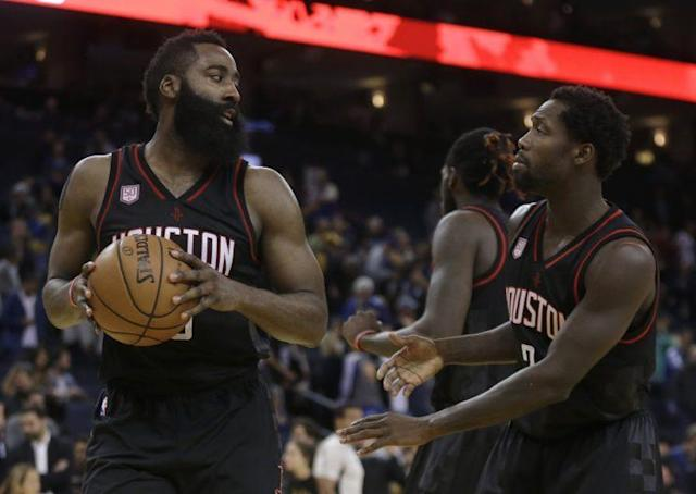 The Rockets played tough for two overtimes to end the Warriors' 12-game winning streak. (Associated Press)