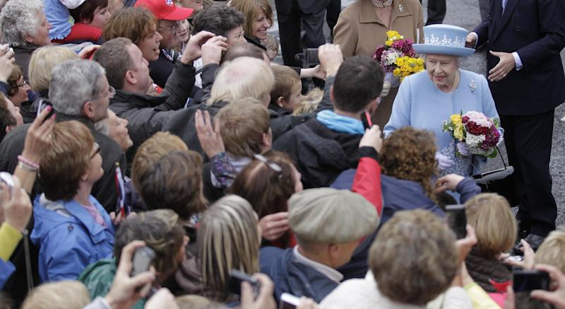 Britain's Queen Elizabeth II meets the public after a Service of Thanksgiving in Saint Macartin's Cathedral in Enniskillen, Northern Ireland, Tuesday, June 26, 2012. The Queen and the Duke of Edinburgh arrived in Northern Ireland for a two day visit to mark the Queen's Diamond Jubilee. (AP Photo/Peter Morrison)