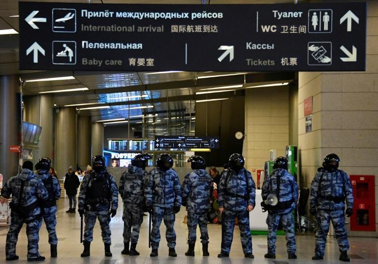 Dozens of police deployed at Vnukovo airport ahead of Navalny's scheduled arrival