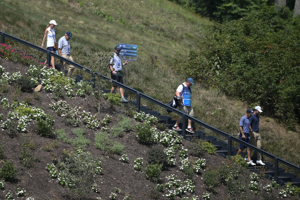 Patrick Cantlay, far right, walks with his group down stairs on their way to the fourth tee box during the ProAm at the BMW Championship golf tournament, Wednesday, Aug. 25, 2021, at Caves Valley Golf Club in Owings Mills, Md. The BMW Championship tournament begins Thursday. (AP Photo/Nick Wass)