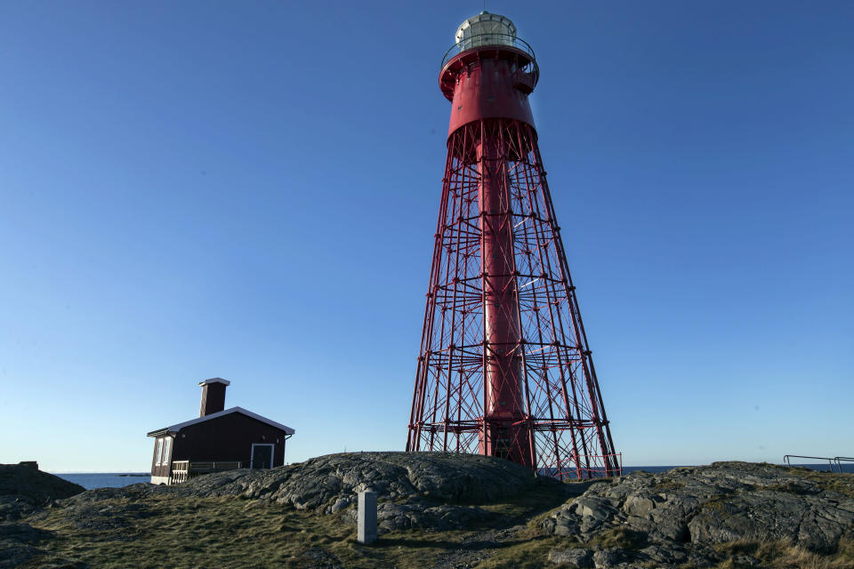 "The lighthouse and cabin, which will act as a screening rooms, on the island of Hamneskar, western Sweden on Saturday, Jan. 30, 2021. The 44th Goteborg film festival opened this weekend in a mostly virtual format but an emergency ward nurse from Sweden was selected among 12,000 volunteers to spend a week on an isolated island in the North Sea with for only companionship the events' entire movie selection. Lisa Enroth said the opportunity gave her ""time to reflect"" after a busy year amid the COVID pandemic. (AP Photo/Thomas Johansson)"