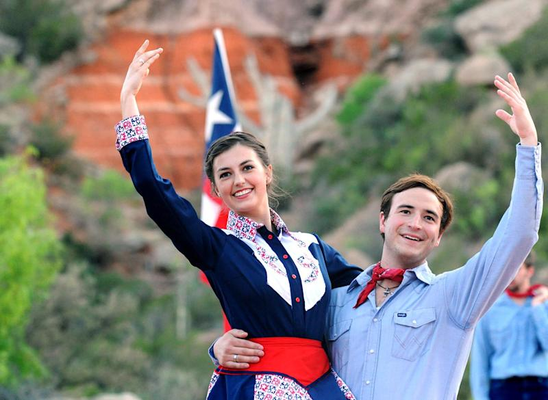 """In this May 21, 2013 photo, """"Texas"""" cast members Alexia Valente, left and Clint Diaz rehearse on stage at the Pioneer Amphitheatre in Palo Duro Canyon, Texas. Five cast members of the musical were killed in an automobile accident Monday night, Aug. 12, 2013 near Dumas, Texas, said Christopher Ray, a Texas Department of Public Safety spokesman. (AP Photo/Amarillo Globe-News, Sean Steffen)"""
