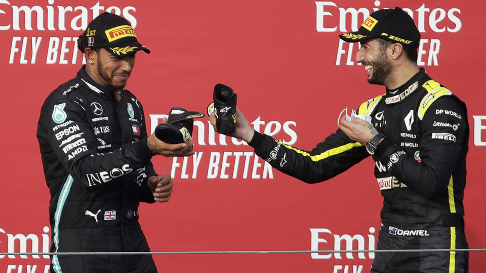 Lewis Hamilton has few peers in the F1 field at the moment - but former champion Jenson Button believes Australia's Daniel Ricciardo is one of them. (Photo by LUCA BRUNO/POOL/AFP via Getty Images)