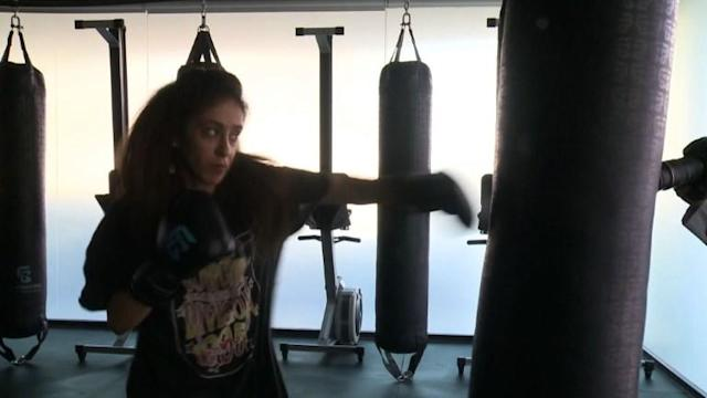 Throwing punches in a gym tucked away from prying eyes, a Saudi female boxing trainer asserts a right long denied to many women in the conservative kingdom -- the right to exercise.