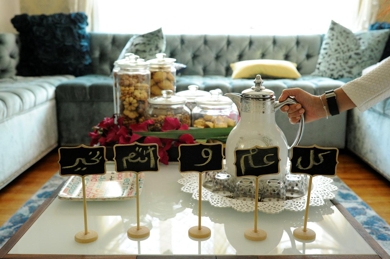 Eid greetings, which wish wellness for the year, make up decorations around sweets and Arabic coffee at the home of the Yemeni-American Muslim Udayni family on the Eid al-Fitr holiday in Brooklyn, New York, U.S., on June 25, 2017.  REUTERS/Kholood Eid