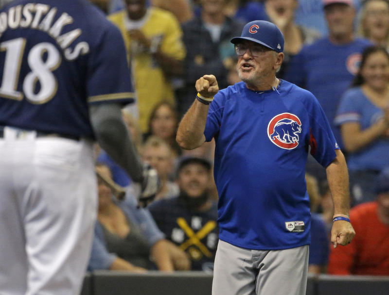 Chicago Cubs' Joe Maddon, right, points to an umpire after being ejected from the game during the eighth inning of a baseball game against the Milwaukee Brewers Monday, Sept. 3, 2018, in Milwaukee. (AP Photo/Aaron Gash)