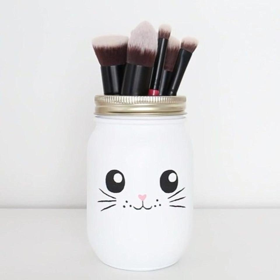 <p>How adorable is this customizable <span>Cat Face Makeup Brush Holder</span> ($12)!?</p>