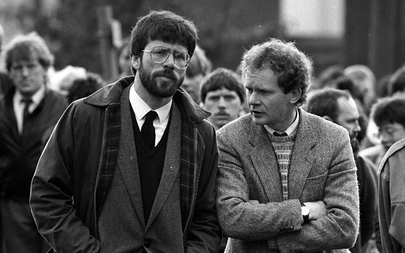 Gerry Adams and Martin McGuinness (right) at the funeral of Patrick Kelly, 30, the reputed IRA commander in East Tyrone - Credit: PA