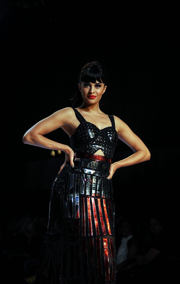 Jacqueline Fernandez showcases a creation by designers Falguni and Shane Peacock during the 'Signature International Fashion Week End' in Mumbai, on November 2013.