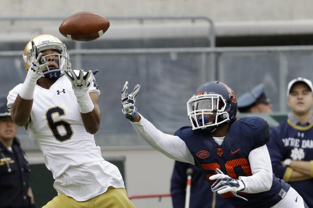 File- This Oct. 1, 2016, file photo shows Notre Dame wide receiver Equanimeous St. Brown (6) catching a touchdown pass as Syracuse defensive back Cordell Hudson (20) defends during the first half of an NCAA college football game in East Rutherford, N.J. The two NFL draft losses that hurt Notre Dame were running back Josh Adams and Brown. Neither is a first-round lock and both would have been focal points in the offense next season. (AP Photo/Julio Cortez, File)