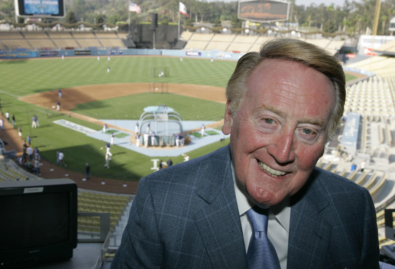 FILE - In this Aug. 1, 2007 file photo, the-ten broadcast voice of the Los Angeles Dodgers, Vin Scully, is shown in the press box of Dodger Stadium in Los Angeles. A pioneering Los Angeles rap group and L.A. broadcasting legend, Scully, are among this year's additions to the prestigious National Recording Registry. The library selects 25 recordings every year for the registry in recognition of their historical, artistic or cultural significance. (AP Photo/Mark J. Terrill, File)