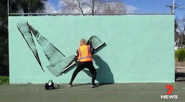 The artist had just finished an unauthorised mural at the Yarraville Tennis Club. Source: 7 News