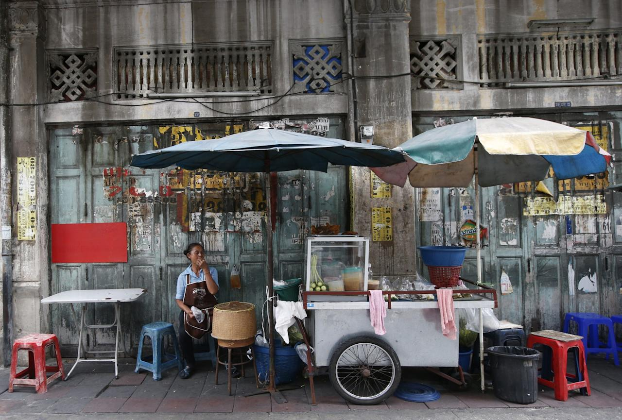 <p>A Thai street food vendor waits for customers at China town in Bangkok, Thailand, Tuesday, June 27, 2017. Bangkok city officials are trying to ban food vendors whose carts sell everything from Thailand's signature noodles to spicy tom yum goong soup which have become institutions on the capital's hot and humid sidewalks. (AP Photo/Sakchai Lalit) </p>