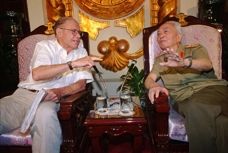 FILE - In this Monday, June 23, 1997, file photo, former U.S. Defense Secretary Robert McNamara, left, speaks to his onetime foe Gen. Vo Nguyen Giap in Hanoi, Vietnam. Officials say Giap, the military mastermind who drove the French and the Americans out of Vietnam, died at a Hanoi hospital Friday, Oct. 4, 2013, at age 102. He was the country's last famous communist revolutionary, and used ingenious guerrilla tactics to overcome enormous odds against superior forces. (AP Photo/Tri Hieu, File)