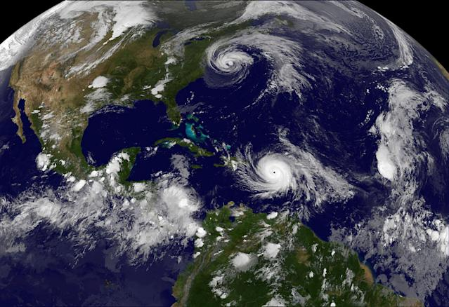 <p>Hurricane Maria which bore down menacingly on the Virgin Islands and Puerto Rico on Tuesday after devastating the tiny island nation of Dominica and Hurricane Jose (top) are both seen in the Atlantic Ocean in this NOAA's GOES East satellite image taken at 21:45 p.m. EDT on September 19, 2017 (0145 UTC, September 20, 2017). (Photo: NASA/NOAA GOES via Reuters) </p>