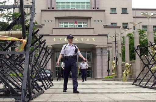Taiwanese police stand guard outside a courthouse in Taipei