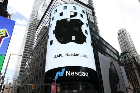 FILE PHOTO: An electronic screen displays the Apple Inc. logo on the exterior of the Nasdaq Market Site in New York City, New York, U.S., August 2, 2018. REUTERS/Mike Segar/File Photo