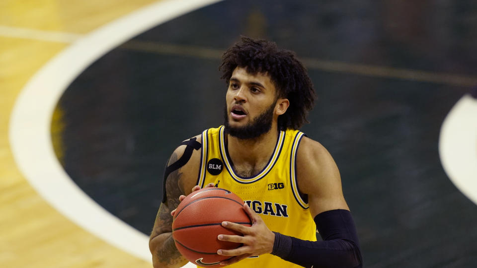 Michigan forward Isaiah Livers plays during the first half of an NCAA college basketball game, Sunday, March 7, 2021, in East Lansing, Mich. (AP Photo/Carlos Osorio)