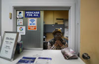Jerome Anderson sits behind a window in a clinic where he distributes Narcan and other medical supplies in St. Louis on Wednesday, May 19, 2021. (AP Photo/Brynn Anderson)