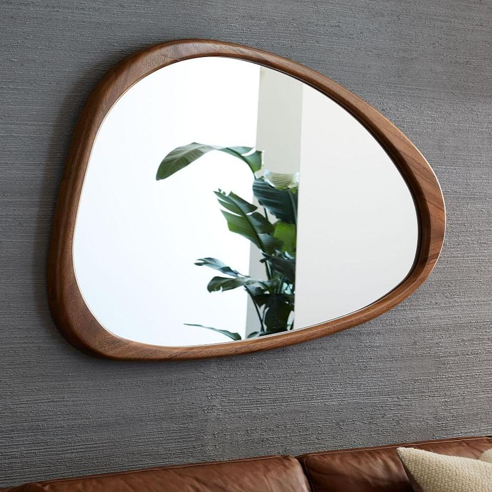 <p>This <span>Mid-Century Asymmetrical Acorn Wood Wall Mirror</span> ($399) will bring a modern elegance to your living room.</p>