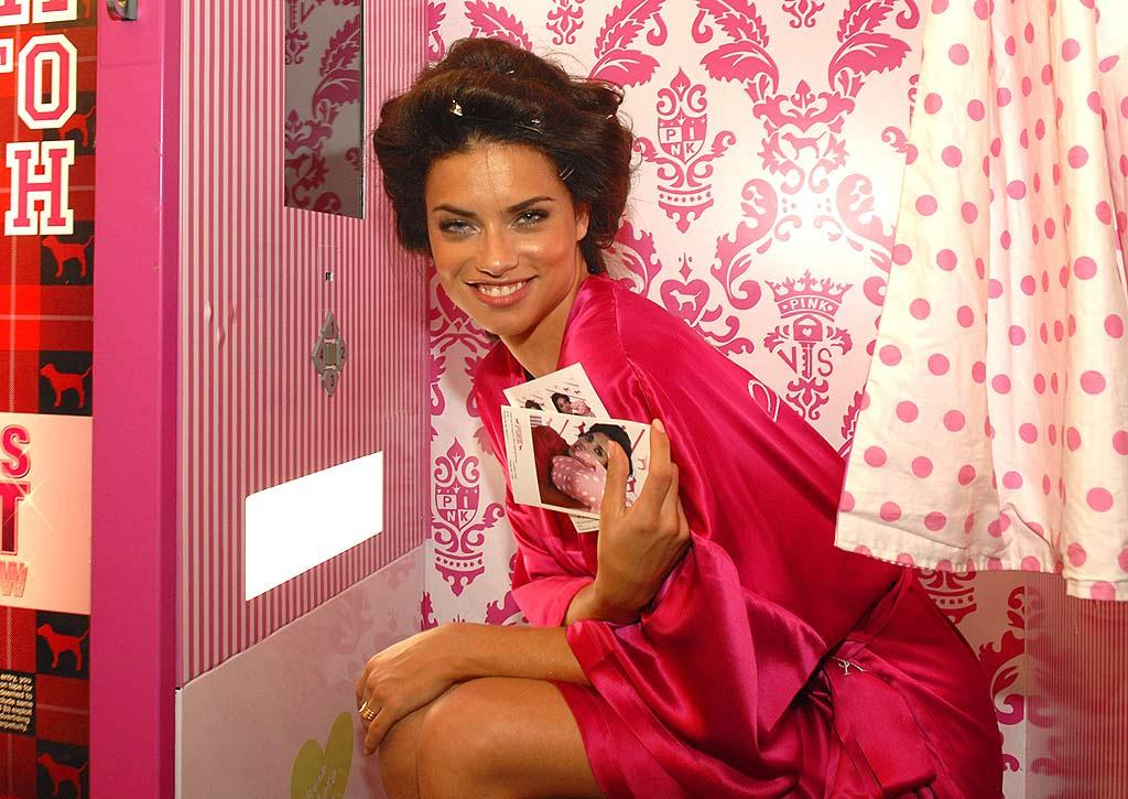 """Adriana Lima clowns around in a pink-themed photo booth. Kevin Mazur/<a href=""""http://www.wireimage.com"""" target=""""new"""">WireImage.com</a> - November 15, 2007"""
