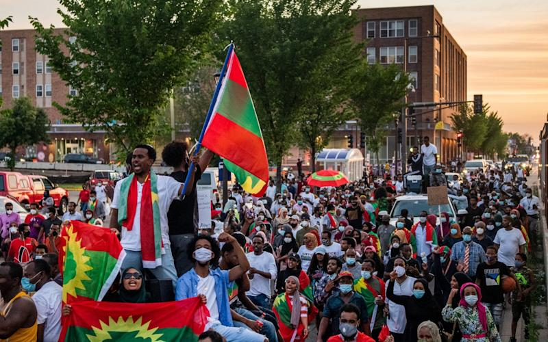 Protesters gather in Minnesota in large numbers following the death of popular Ethiopian singer and activist Hachalu Hundessa - Brandon Bell/Getty Images North America