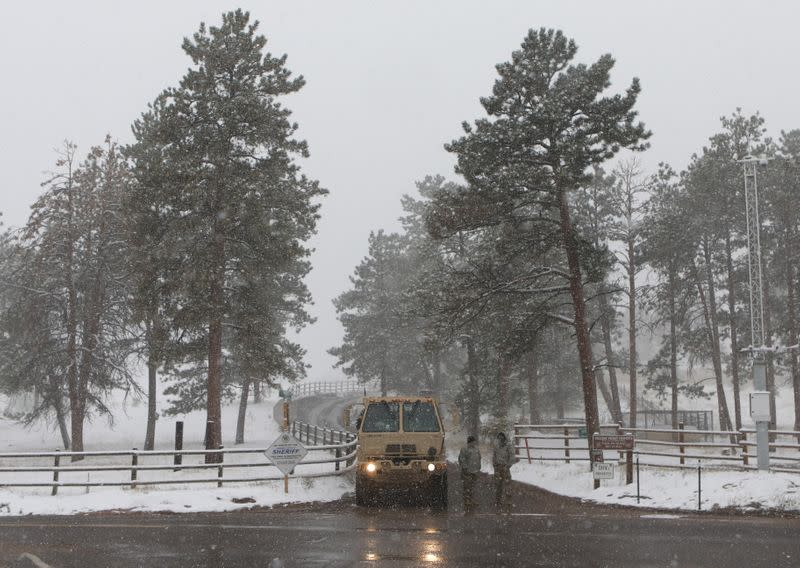 Central U.S. goes from heatwave to winter in a day as snowstorm rolls through the region