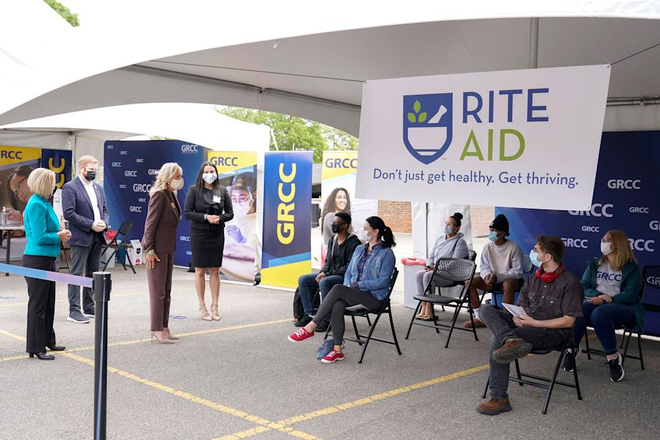 First Lady Jill Biden (C) tours the vaccination clinic with Yasheka Sharma of Rite Aid (R), Grand Rapids Mayor Rosalynn Bliss (L), and Rep. Peter Meijer, R-Michigan (2nd L), at Grand Rapids Community College's downtown campus in Grand Rapids, Michigan, on May 27, 2021. (Photo by Carolyn Kaster / POOL / AFP) (Photo by CAROLYN KASTER/POOL/AFP via Getty Images)