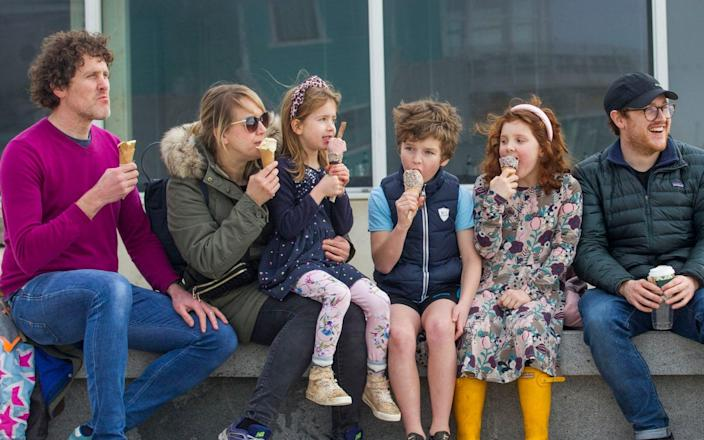 251607236 / f6cbea0d-213a-3557-832b-a36cabe4c5c8 Original description: The Buckland family (permissions granted) enjoy ice creams today as the sun came out on the seafront in Brighton ***Pic by David McHugh / Brighton Pictures 07768 721637*** Source: Brighton Pictures Filename: TELEMMGLPICT000251607236.jpeg - David McHugh/Brighton Pictures