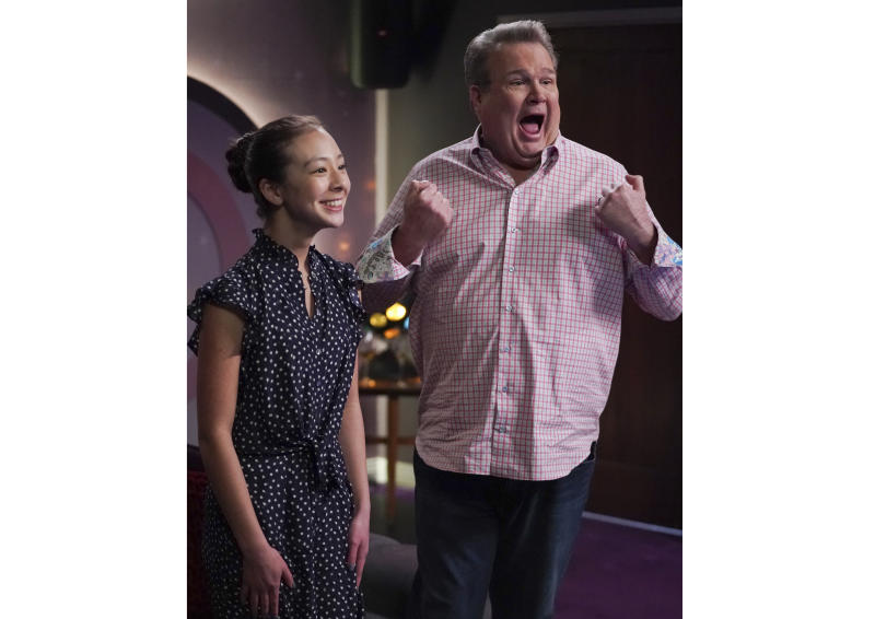 """This image released by ABC shows Aubrey Anderson-Emmons, left, and Eric Stonestreet in a scene from """"Modern Family.""""  The popular comedy series ends its 11-season run with a two-hour finale on Wednesday. (Eric McCandless/ABC via AP)"""
