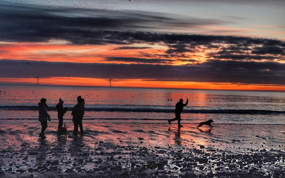 People walking on Blyth beach in Northumberland, Sunday February 28 - Owen Humphreys /PA Wire