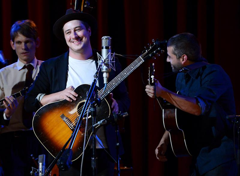 """Musicians Marcus Mumford, left, and Oscar Isaac perform together during """"Another Day, Another Time: Celebrating the Music of Inside Llewyn Davis"""" at The Town Hall on Sunday, Sept. 29, 2013 in New York. (Photo by Evan Agostini/Invision/AP)"""