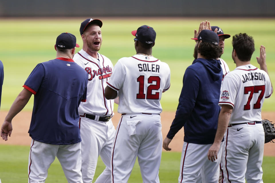 Atlanta Braves closer Will Smith (51) celebrates after the ninth inning of Game 3 of a baseball National League Division Series against the Milwaukee Brewers, Monday, Oct. 11, 2021, in Atlanta. The Atlanta Braves won 3-0. (AP Photo/Brynn Anderson)