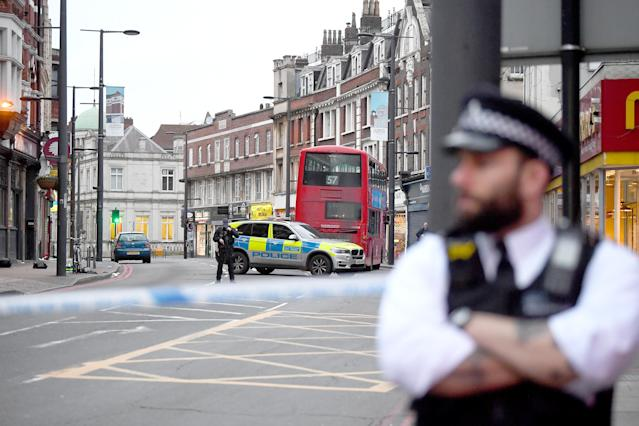 Police at the scene in Streatham High Road, south London. (PA Images)