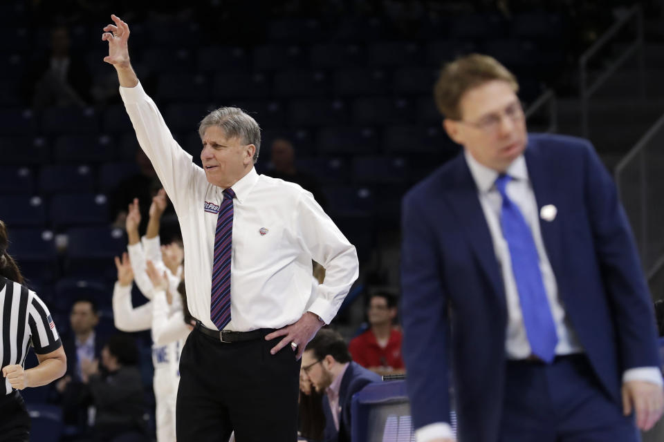 DePaul head coach Doug Bruno, left, calls his team during the second half of an NCAA college basketball game against Seton Hall in the Big East women's tournament semifinals, Sunday, March 8, 2020, in Chicago. (AP Photo/Nam Y. Huh)