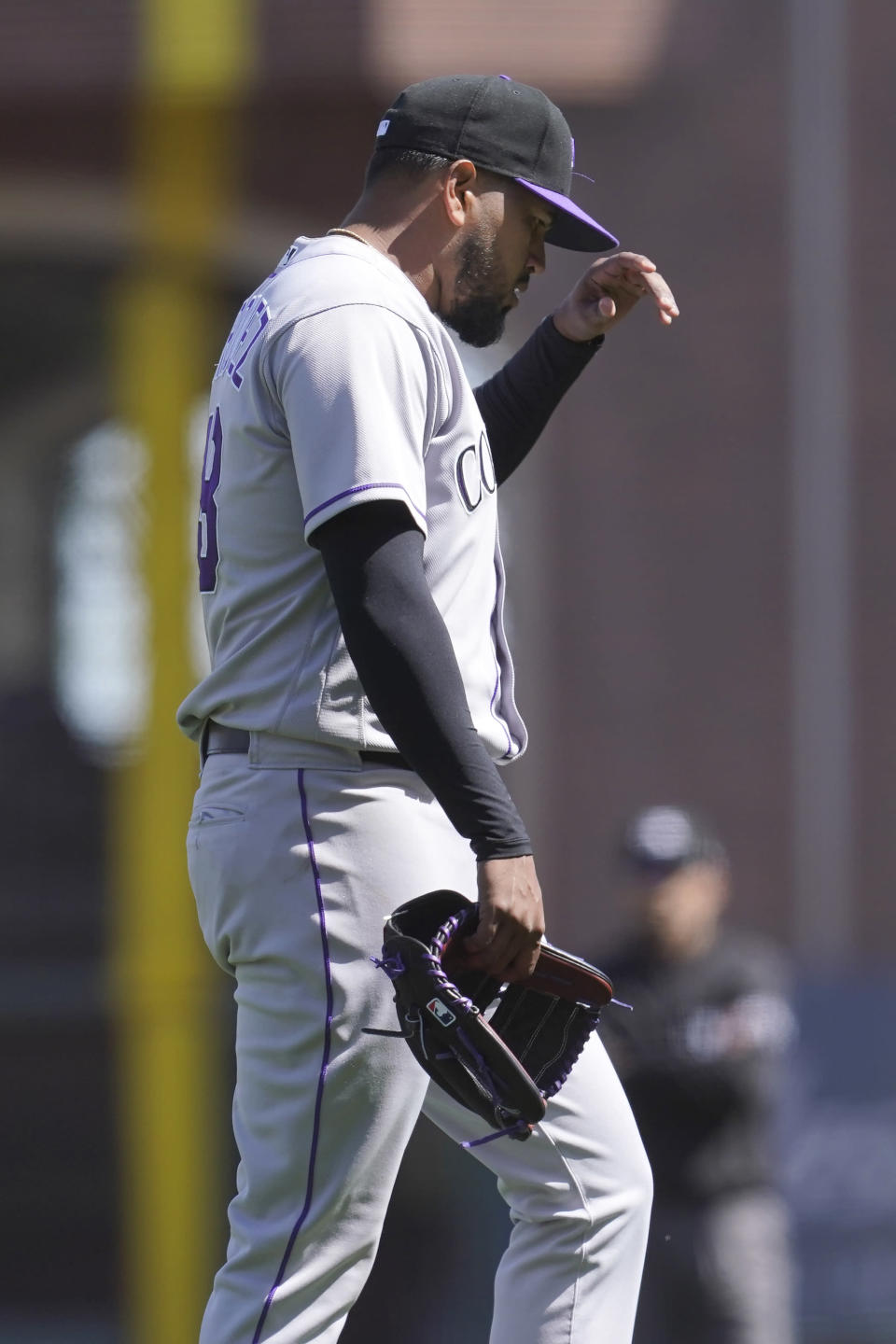 Colorado Rockies pitcher German Marquez walks toward the dugout after being relieved during the sixth inning of a baseball game against the San Francisco Giants in San Francisco, Sunday, April 11, 2021. (AP Photo/Jeff Chiu)