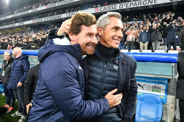 Marseille boss Andre Villas-Boas (L) got the better of Portuguese counterpart Paulo Sousa on Sunday (AFP Photo/GERARD JULIEN)
