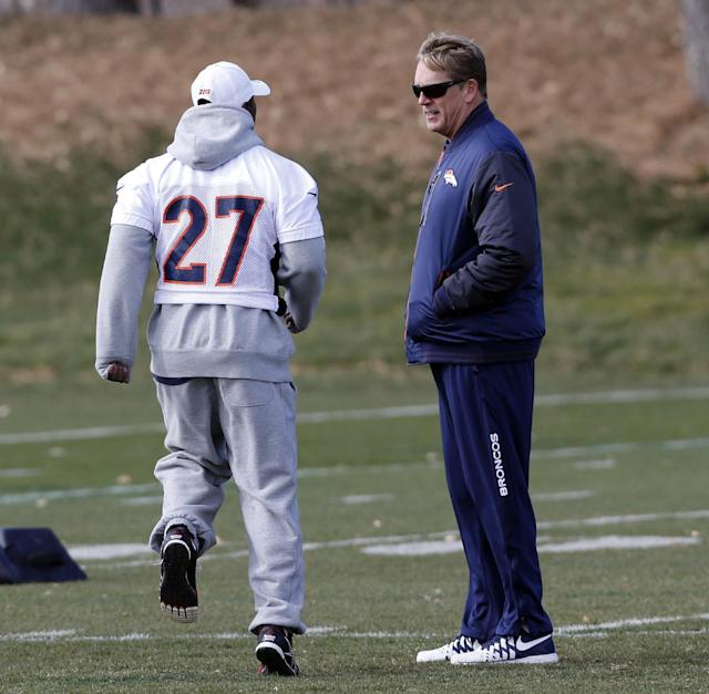 Denver Broncos interim head coach Jack Del Rio, right, talks to running back Knowshon Moreno as the team practices at the NFL football team's practice facility in Englewood, Colo., on Monday, Nov. 4, 2013. Del Rio, the defensive coordinator, will serve as head coach while John Fox recovers from heart surgery. (AP Photo/Ed Andrieski, File)