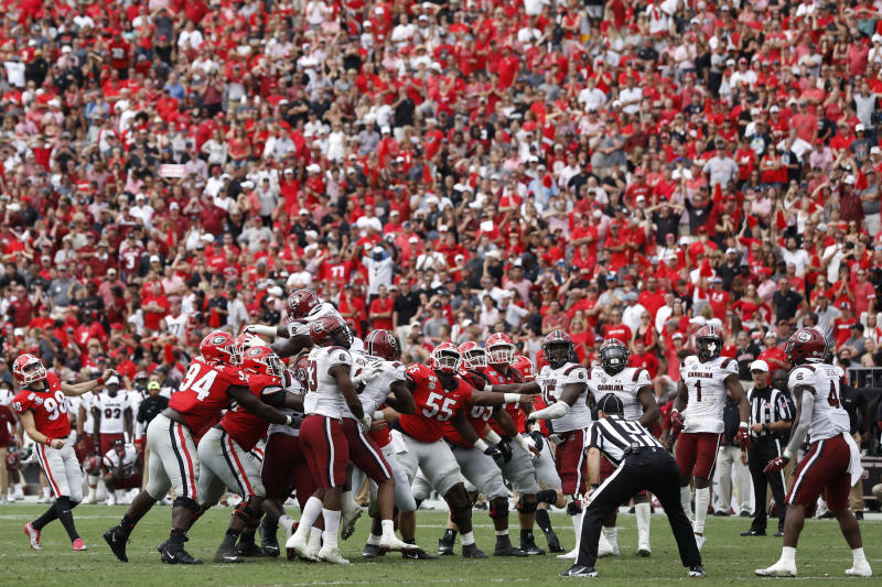 Georgia placekicker Rodrigo Blankenship (98) looks on as his field goal kick goes wide left during the second overtime against South Carolina in an NCAA college football game in Athens, Ga., on Saturday, Oct. 12, 2019. South Carolina won 20-17 in double overtime.  (Joshua L. Jones/Athens Banner-Herald via AP)