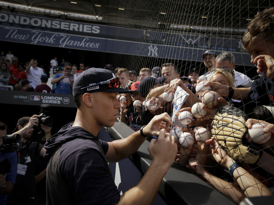 New York Yankees right fielder Aaron Judge signs autographs after batting practice in London, Friday, June 28, 2019. Major League Baseball will make its European debut with the New York Yankees versus Boston Red Sox game at London Stadium this weekend. (AP Photo/Tim Ireland)