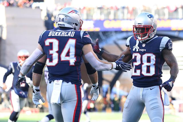 On Sunday, Patriots running back James White, right, tied the NFL postseason record for receptions in a game with 15. (Getty Images)