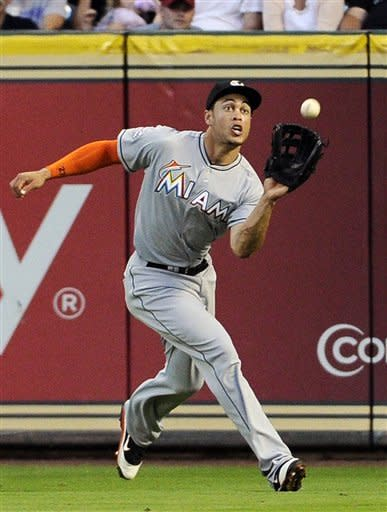 Miami Marlins right fielder Giancarlo Stanton makes a catch for an out on Houston Astros' Jed Lowrie in the third inning of a baseball game on Wednesday, May 9, 2012, in Houston. (AP Photo/Pat Sullivan)