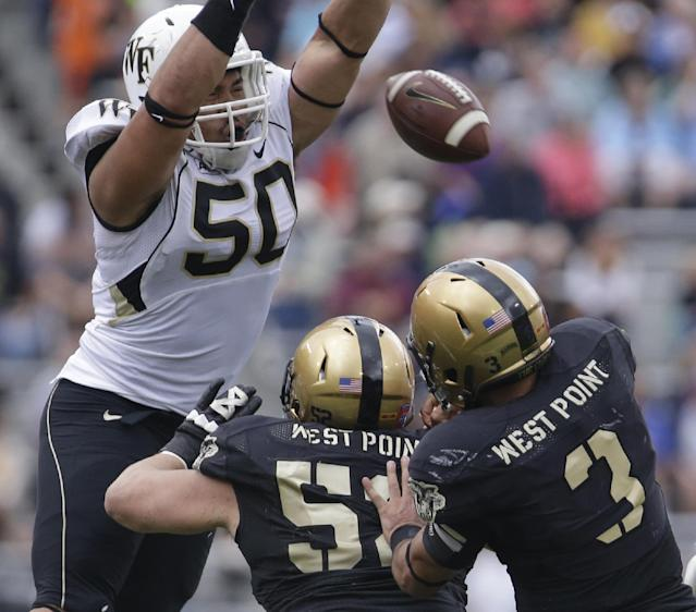 Wake Forest nose tackle Nikita Whitlock (50) blocks a pass by Army quarterback Angel Santiago (3) during the first half of an NCAA college football game on Saturday, Sept. 21, 2013, in West Point, N.Y. (AP Photo/Mike Groll)