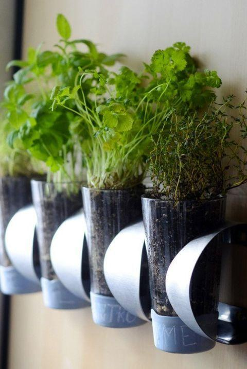 """<p>This wine rack can store a lot more than your favorite reds and whites: Squeeze pint glasses with your favorite herbs into the compartments to make a DIY hanging garden.</p><p>See more at <a href=""""http://www.curbly.com/users/faith-towers/posts/15005-how-to-indoor-herb-garden-ikea-hack"""" rel=""""nofollow noopener"""" target=""""_blank"""" data-ylk=""""slk:Curbly"""" class=""""link rapid-noclick-resp"""">Curbly</a>.</p><p><em><a class=""""link rapid-noclick-resp"""" href=""""https://www.amazon.com/WMF-0641306040%C3%83%C3%82-Gourmet-Herb-Garden-Set/dp/B00S17UAS6/?tag=syn-yahoo-20&ascsubtag=%5Bartid%7C2089.g.29514474%5Bsrc%7Cyahoo-us"""" rel=""""nofollow noopener"""" target=""""_blank"""" data-ylk=""""slk:BUY NOW"""">BUY NOW</a> <strong>Herb Garden Set, $57, <span class=""""redactor-unlink"""">amazon.com</span></strong></em></p>"""