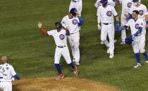 Chicago Cubs' Cameron Maybin, on mound, gestures after walking to force in the the winning run against the Cleveland Indians in a baseball game Tuesday, Sept.15, 2020, in Chicago. (AP Photo/David Banks)