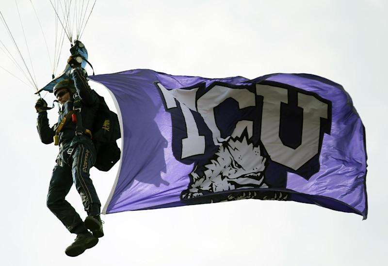 FILE - In this Jan. 1, 2011 file photo, a parachutist lands inside the Rose Bowl flying a TCU flag prior to the Rose Bowl NCAA college football game between TCU and Wisconsin, in Pasadena, Calif. Police say four TCU football players are among 17 students who have been arrested in a campus drug bust. TCU Police Chief Steve McGee said the students arrested Wednesday, Feb. 15, 2012,  were caught in an undercover operation selling marijuana, cocaine, ecstasy and prescription drugs.  (AP Photo/Jae Hong, File)