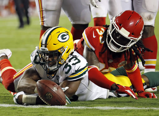 Green Bay Packers running back Aaron Jones (33) fumbles the ball after a tackle by Kansas City Chiefs cornerback Tremon Smith (39) during the first half of an NFL preseason football game in Kansas City, Mo., Thursday, Aug. 30, 2018. Packers wide receiver Trevor Davis recovered the fumble. (AP Photo/Charlie Riedel)