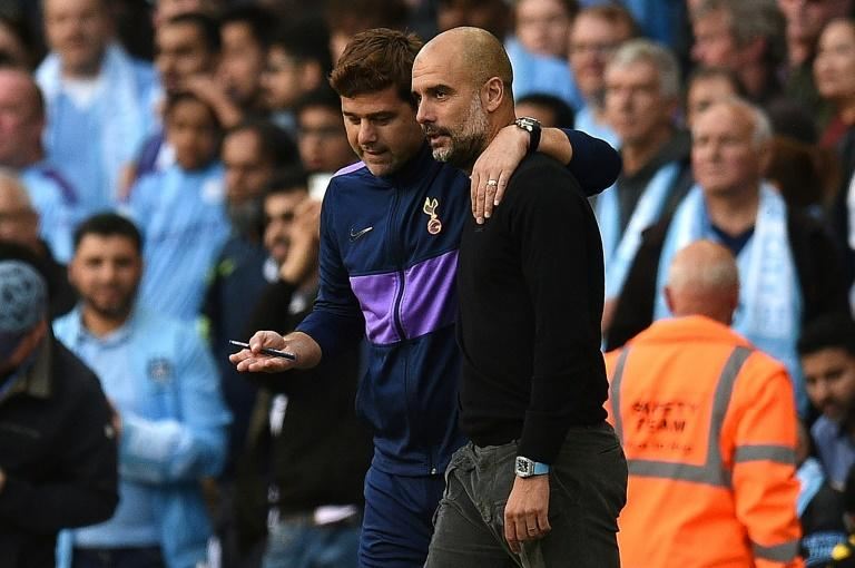 Spoils shared: Mauricio Pochettino (left) and Pep Guardiola (right) embrace after Manchester City and Tottenham drew 2-2 on Saturday (AFP Photo/Oli SCARFF                          )